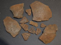 A group of 12 x assorted larger shards of rare Early Anglo Saxon Pagan period pottery, some nicely decorated, from Lackford, Suffolk. (Lot 3)